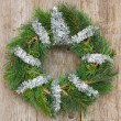 Stock Photo: Christmas wreath hung on wall