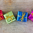 Stock Photo: Four gifts on the wooden floor