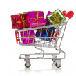 Shopping cart with colorful gift boxes — Stock Photo #17201629