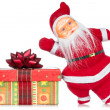 Santa claus with christmas gift — Stock Photo
