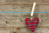 Heart hang over a wooden background — Stock Photo