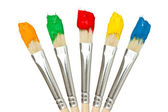 Five paintbrushes with color paints — Stock Photo