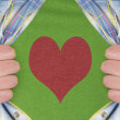 Stock Photo: The heart symbol on a green T-Shirt