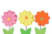 Tři barevné dřevěné květy — Stock fotografie
