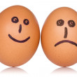 图库照片: Happy and angry eggs