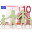 Paper family and ten Euro banknote — Stock Photo