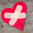 Stock Photo: Broken heart on wooden background