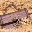 Treasure chest with  the gold  on a sandy beach — Stock Photo