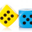 Yellow and blue game dices — Stock Photo