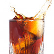 Splash of brown beverage — Stockfoto