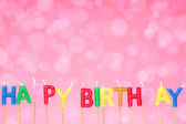 Birthday candles on the pink background — Stock Photo
