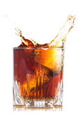 Splash of brown beverage — Stock Photo