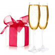 Glasses of champagne and a gift box — Stock Photo