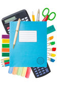 Blue exercise book with school supplies — Stock Photo
