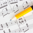 Musical notes with yellow pencil — Stock Photo