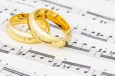 Golden rings on the sheet music — Stock Photo
