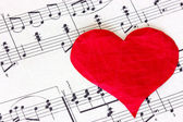 Music note book with red heart — Stock Photo