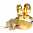 Padlock with golden rings on white background — Stock Photo