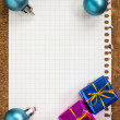 Baubles and gifts with empty paper sheet — Stock Photo