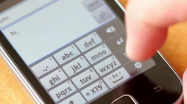 Hand texting or typing on a touchscreen smartphone — Stock Video