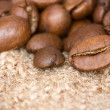 Coffee beans on the burlap texture — Stock Photo
