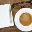 Notebook, glasses and  coffee cup — Stock Photo