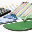 Business chart with calculator and pens — Stock Photo