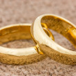 Wedding rings on the burlap — Stock Photo
