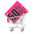 Shopping cart with sale tag — Stock fotografie