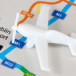 Airplane on the map — Stock Photo