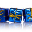 Three blue glossy gift boxes — Stock Photo