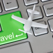 Plane on keyboard with travel button — Stockfoto
