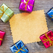Christmas card with a colorful gifts — Stock Photo