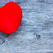 Red heart on blue board — Stock Photo