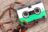 Retro audio cassette on the wood background — Foto Stock