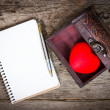 Heart in the box and notebook with a pen — Stock Photo