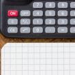 Calculator, pen and notepad on the table — Stock Photo