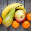 Stock Photo: Fruits on the old wooden floor