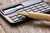 Close-up calculator with pen — Stock Photo