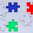 Stock Photo: Puzzle with different colored pieces