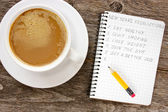 New year resolutions with coffee cup — Stock Photo