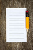 Pencil and lined paper — Stockfoto