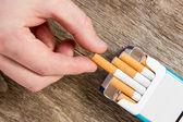 Hand takes a cigarette — Stock Photo