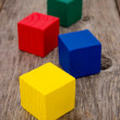 Colorful cubes on the old floor — Stock Photo
