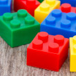 Stock Photo: Plastic blocks on the wooden background