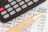 Invoice with calculator and pen — Stock Photo