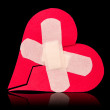 Stock Photo: Broken heart fixed with adhesive bandage