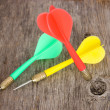 Color darts on a wooden background — Stock Photo