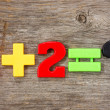 Math example with plastic numbers — Stock Photo