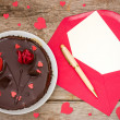 Chocolate cake and love letter — Stock Photo
